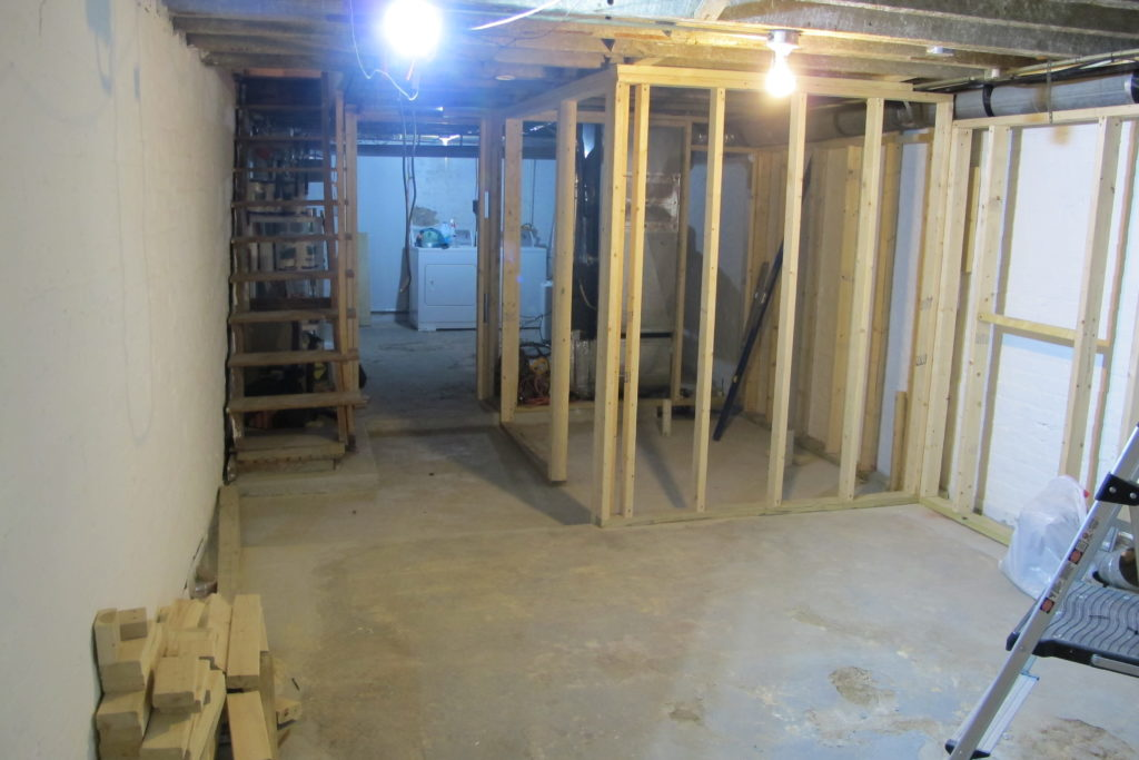 1904 rowhome basement transformation - framing and lighting the space | EffieRow.com  #basementrenovation #basementtransformation #basementreno #smallbasement #darkbasement #basementbathroom #basementaddition #exposedbasementceiling