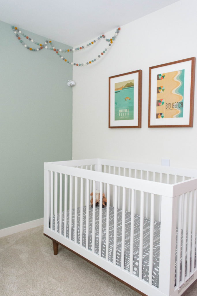 Maui-themed nursery with Baby Mod crib and a matching Ikea Kallax changing table. Love the modern and colorful accents!