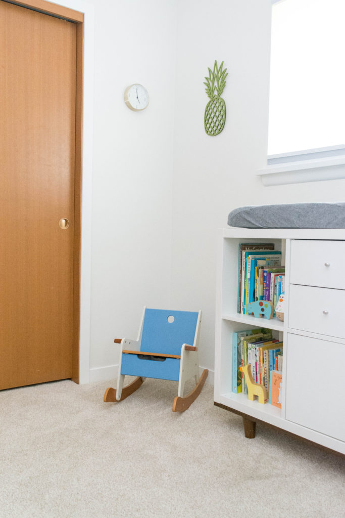 Gender neutral nursery in a mid century home. This is what leaving oak doors unpainted look like - adding new trim makes a big difference! Trim is BM Simply White and the walls are BM White Dove.