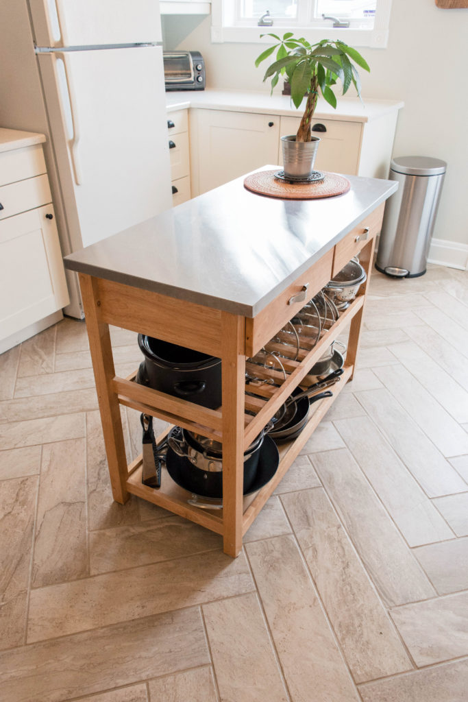 Kitchen island cart for extra storage and counter space. Also loving the herringbone tile floors. |  From EffieEow.com