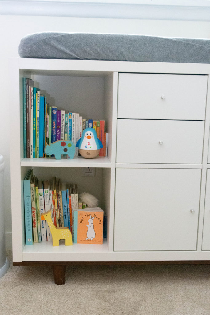 Custom Ikea Kallax changing table with tapered legs.