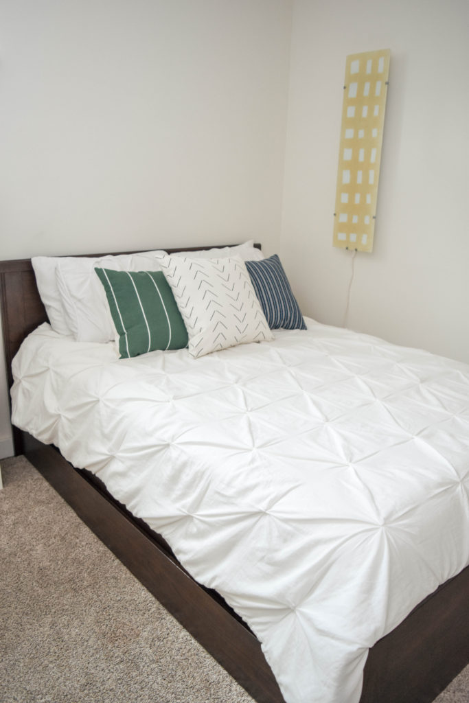 Simple guest room on a budget. Bed has storage underneath for extra linens.