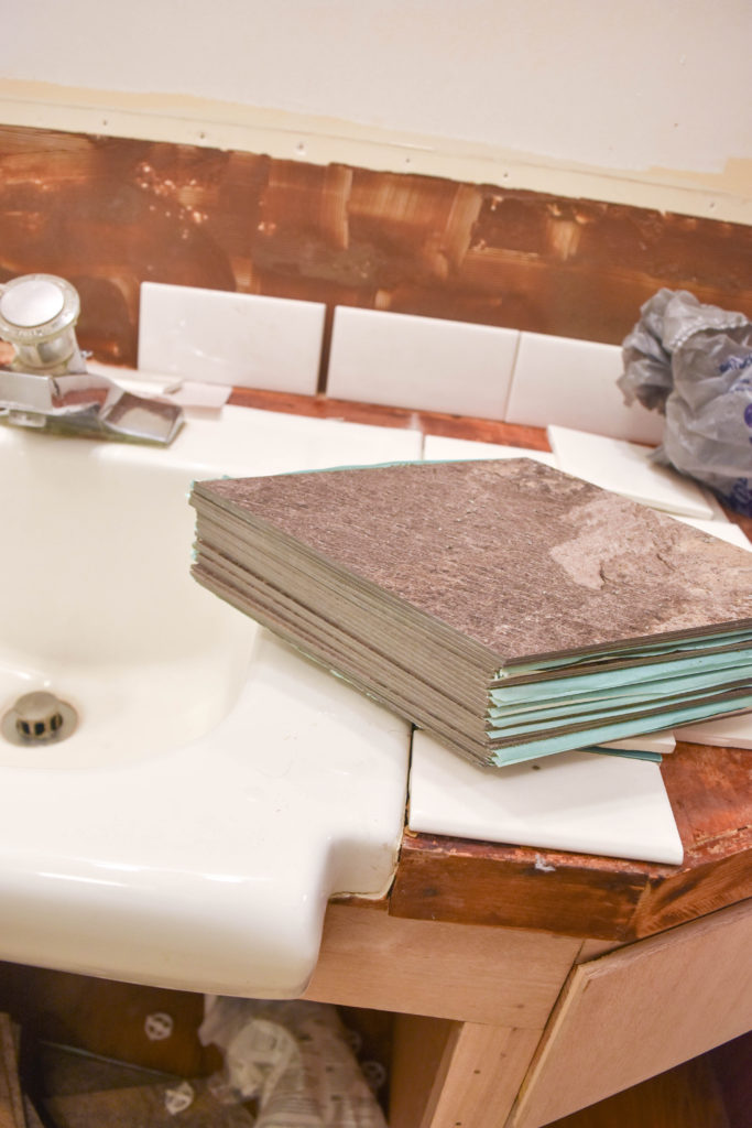 How to lay custom vinyl tile floors - great option for a bathroom renovation and easy way to cover up existing floors. Cut inexpensive vinyl tiles and lay them in any pattern you choose!