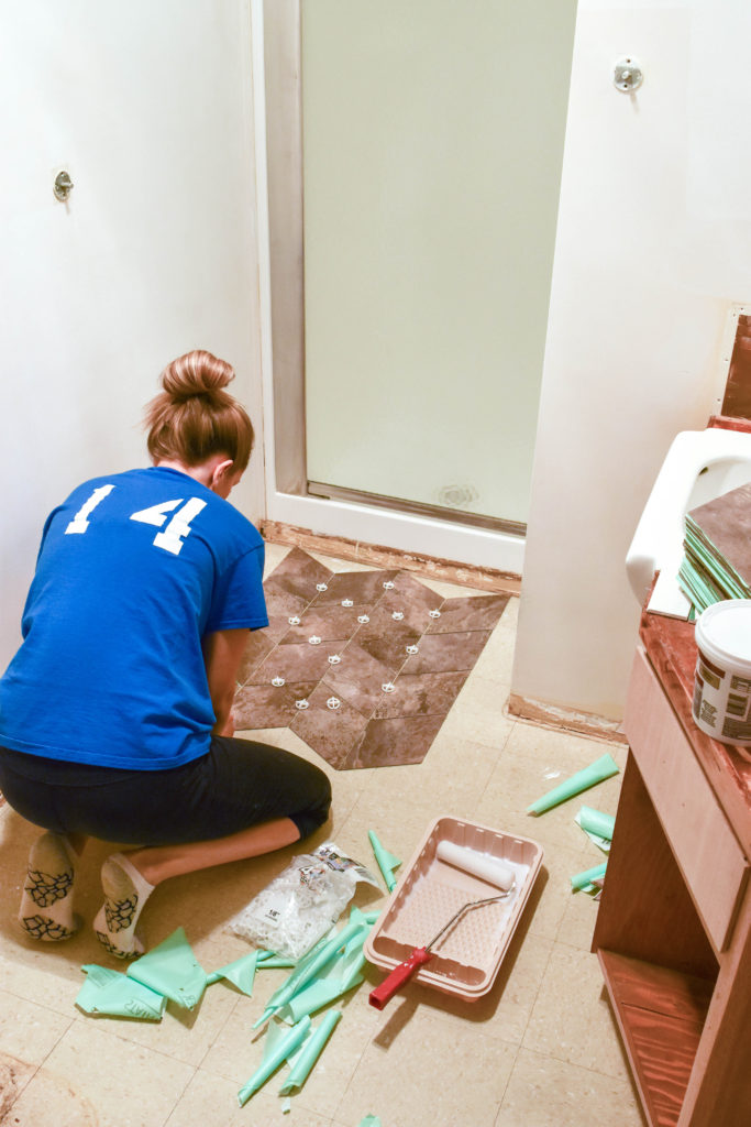 How to lay custom vinyl tile floors - great option for a bathroom renovation and easy way to cover up existing floors!