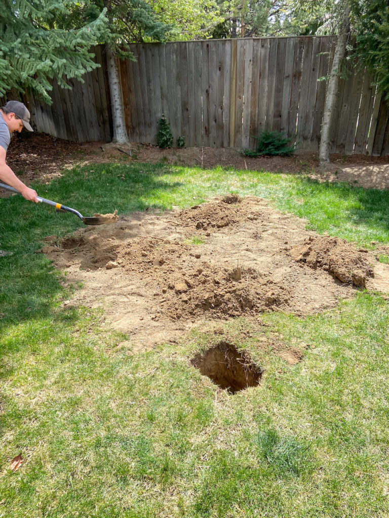 Digging holes for a playhouse deck install.