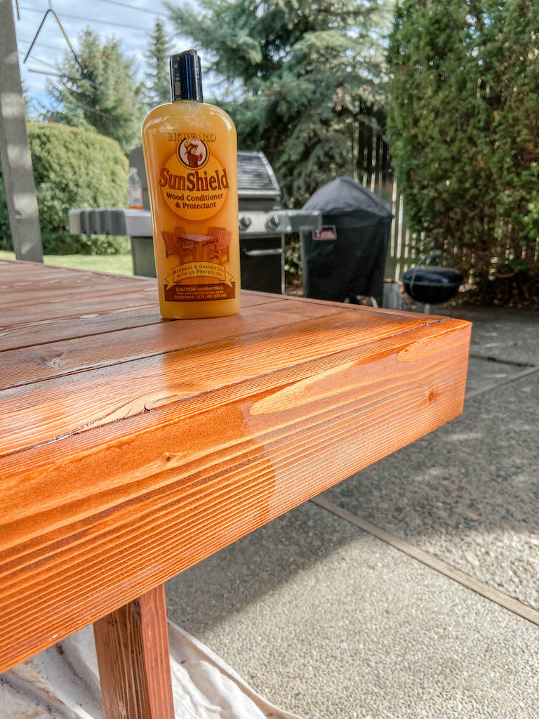 Refinishing our DIY modern patio table with Cabot Australian Timber Oil and Howard's SunShield Wax. | EffieRow.com