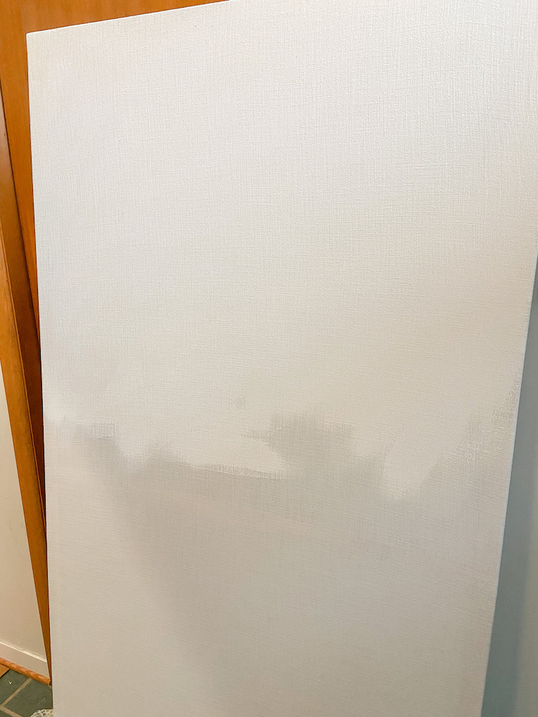 Creating the canvas for our large-scale textured wall art. | EffieRow.com  #budgetfriendlyart #diywallart #texturedcanvas #diytexturedcanvas #diycanvas